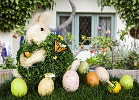 Spring Flowers In English Beach Cottage  ~ Beautiful Spring or Easter Scene With, Rabbit, Painted Eggs, Espalier Apple Tree, Wicker Fence and Enchanted Garden