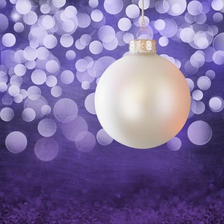 White Vintage Christmas Ball Ornament Over Elegant Purple & White Christmas Light Bokeh & Snow Crystal Grunge Background