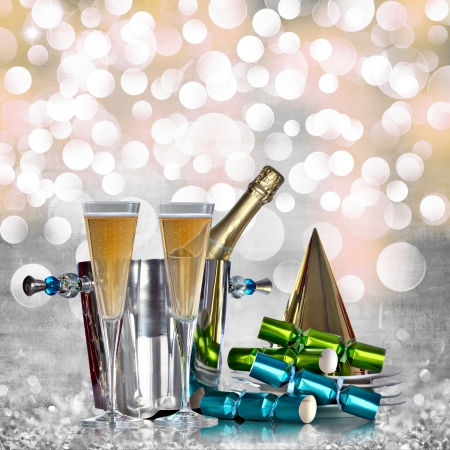 new years eve: Champagne Glasses In Silver Bucket With White Plates, Gold Party Hat, and Green And Blue Party Favors Over Elegant Grunge Silver, Gold, Purple, Pink Christmas Light Bokeh & Crystal Background  Stock Photo