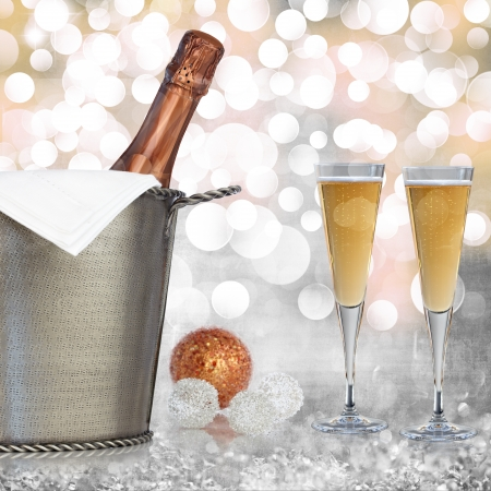 Champagne In Vintage Silver Bucket With Hammered Texture, Bronze Ornaments, & Glasses Of Champagne Wine Over Elegant Grunge Silver, Gold, Purple, Pink Christmas Light Bokeh & Crystal Background