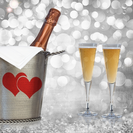 Champagne In Vintage Silver Bucket With Hammered Texture, Bronze Ornaments, & Glasses Of Champagne Wine Over Elegant Grunge Silver, Pink, Red Valentines Heart Light Bokeh & Crystal Background
