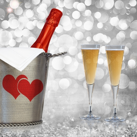 Champagne In Vintage Silver Bucket With Hammered Texture, Bronze Ornaments, & Glasses Of Champagne Wine Over Elegant Grunge Silver, Pink, Red Valentines Heart Light Bokeh & Crystal Background  photo