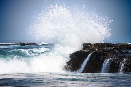 Pure Blue Waters Of California s Pacific Ocean, Coastal Waves Breaking And Splashing On Sea Coast Rocks Encrusted With Mussels