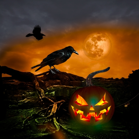 Scary Twilight Full Moon with orange sky and pumpkin