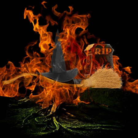 Melted Wicked Witch With Hat and Broom Stick at Spooky Graveyard With Burning Fire Archivio Fotografico