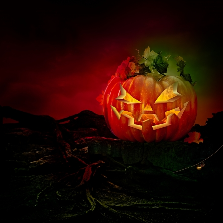 Spooky Scary Laughing Jack O Lantern Carved Pumpkin With Burning Fire and Flames  photo
