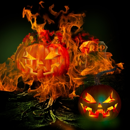 remembrance day: Spooky Scary Graveyard With Burining Fire and Flames Engulfing Grave Stone With Rest In Peace