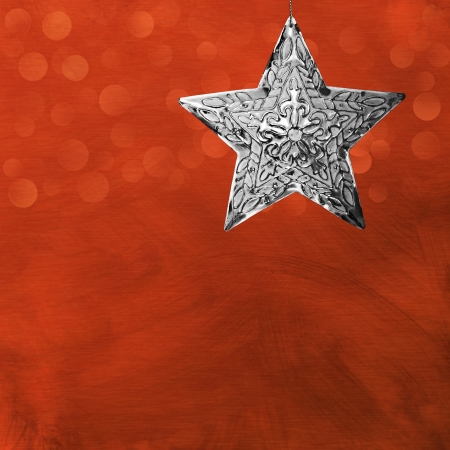 Silver Star Christmas Ornament Over Brushed Metal Background With LED Bokeh Lights
