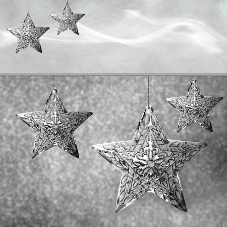 Group of Silver Star Shaped Snowflakes On Neutral Sparkling Gray Christmas Light Holiday Background
