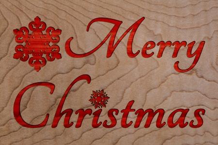 merry christmas text: Saludo de la Feliz Navidad Texto tallada en madera de textura de fondo, Handemade sesi�n para la tarjeta del d�a de fie O Invitaci�n Con Copyspace Foto de archivo