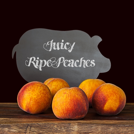 Group Of Juicy Farm Fresh Whole Ripe Peaches With Vanilla Bean Pods On A Decorative Wooden Breakfast Or Lunch Platter And A Dark Chalkboard Background Wallpaper Background