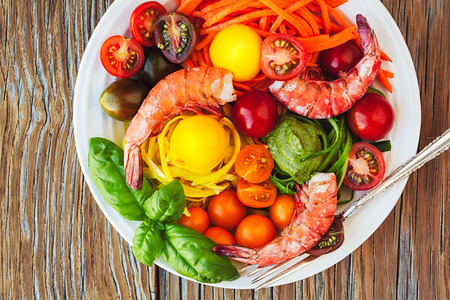 Vegetable Zucchini Spaghetti Pasta Noodle Dish With Fresh Shrimp, Basil Pesto, Heirloom Tomatoes, Sous Vide Egg Yolks, Carrots On Instagram Style Vintage Wood Table