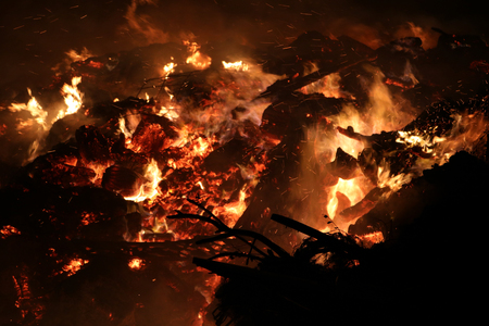 Extreme closeup of roaring fire with sparks showering Stock Photo