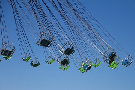 chairoplane: sitting of a swing carousel in front of blue sky