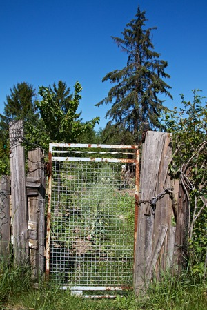 an old rusted garden gate