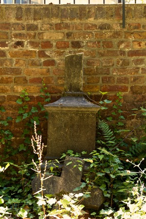 godliness: weathered grave with Broken Tomb