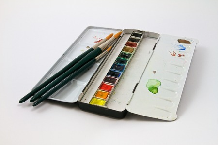 writing materials: Watercolor paints set with brushes