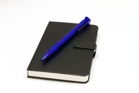 Black notebook with blue ballpoint pen Standard-Bild