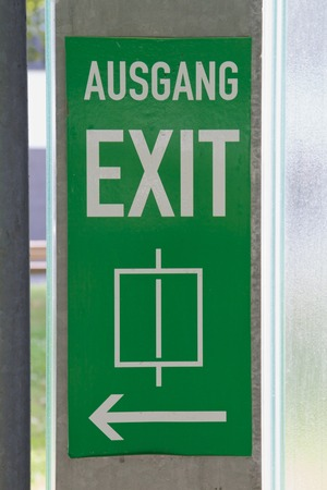 green signpost Exit with regard to lift