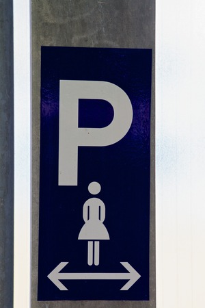 Sign for parking spaces reserved for women photo