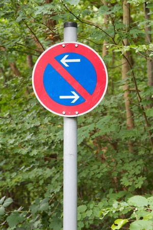 German traffic sign: Restricted parking zone with forest in the background