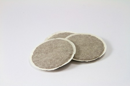 Three coffee pads on a white background