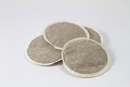 four coffee pads on a white background Standard-Bild