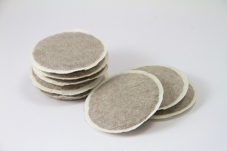 eight coffee pads on a white background Standard-Bild
