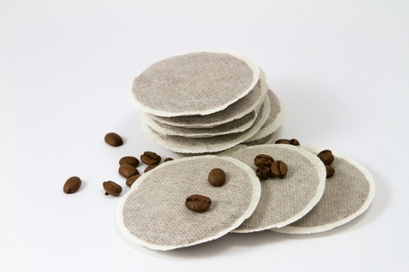 coffee pads on a white background with coffee beans Standard-Bild