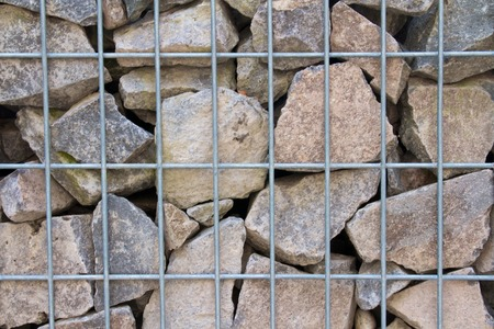 gabion mesh: Detail of a gabion wall filled with broken limestone Stock Photo