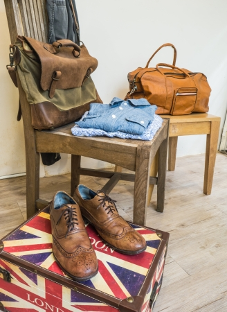 duffle: Vintage male clothing   Brown wingtip leather shoes, Two chambray shirts ,  Vintage leather messenger bag , Duffle Bag ,Vintage gray jacket, and Fedora hat