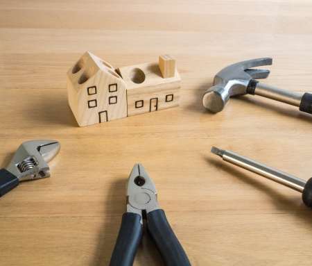 Set of tools and wood house toy  photo