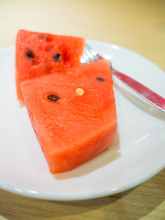 Fresh slices of red watermelon on the plate  photo