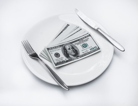 cupidity: American US dollar on the white plate  Concept is corruption