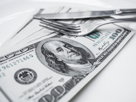 covetous: American US dollar on the white plate  Concept is corruption