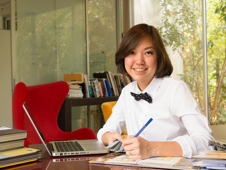 home office interior: Portrait of Asian woman interior designer working at the home office  Stock Photo