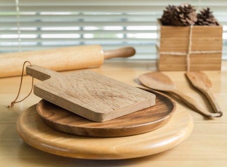cooking implement: Chopping board and baking utensils on the wood table Stock Photo