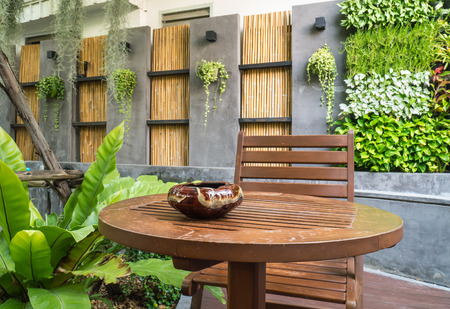 ashtray on the outdoor wood coffee table in the garden photo