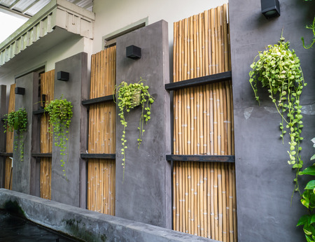 Decorate of cement and bamboo wall Stock Photo - 28092719