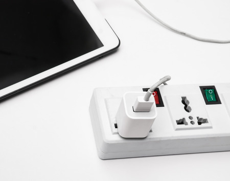 bloc: Tablet charging battery at bloc  Stock Photo