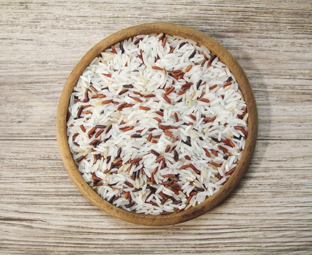 Close up white and red rice mixed on the wooden plate ,  uncooked raw cereals Stock Photo