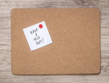 Cork board frame with have a nice day note message photo