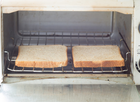 wheat toast: Whole wheat toast in the oven.Vintage effect style picture