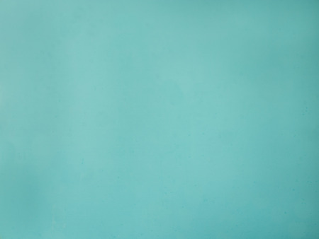 exterior wall: Teal blue green cement wall texture background