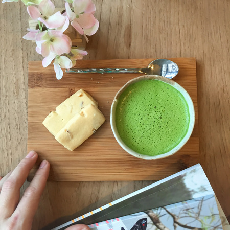 matcha: Top view of  Matcha Green Tea and cookie on wooden tray.