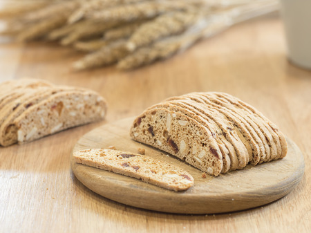 almond biscuit: Slice almond  biscuit cookie on wooden tray