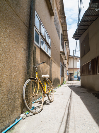 outdoor sport: bicycle lean on a wall in street of old town Stock Photo