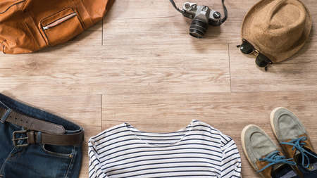 Top view of Vintage clothing and accessories on the wooden background ( Composition and space for text )