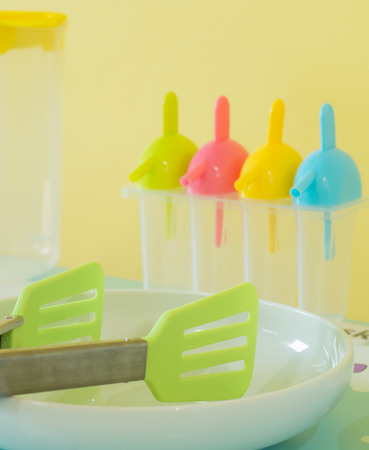 Plastic Toy Kitchen Utensils And Tableware Toys On A Table Stock Photo    47997350