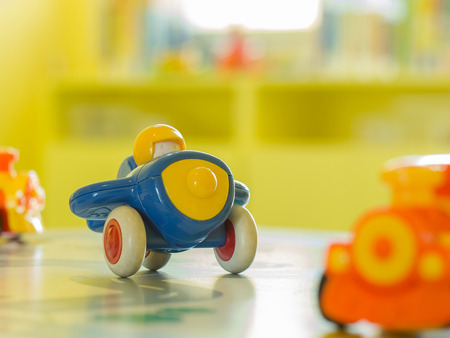 plastic toys: children toys - Blue plastic toy airplane and another toy on a table Stock Photo